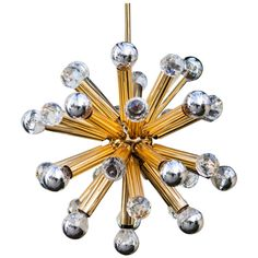 Golden Sputnik Chandelier with Swarovski Crystals | From a unique collection of antique and modern chandeliers and pendants  at http://www.1stdibs.com/furniture/lighting/chandeliers-pendant-lights/