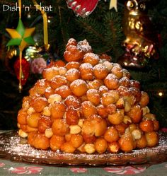 Struffoli a sweet Italian tradition. My mother used to make this at Christmas, she shaved chocolate and orange rind over it.