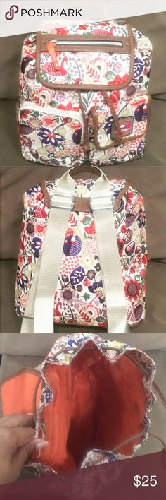 Lily Bloom Back Pack New Without Tags Lily Bloom's handbags and accessories revel in vibrant colors and feminine prints. Each piece features their signature fabric created made recycled plastic bottles this is perfect for the responsible lady. 13inches length and 11 inches across and 7 1/2 inches base. Clean inside and out. Lily Bloom Bags Backpacks