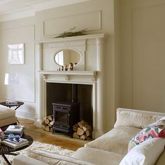 love the mirror and simple elegance .fireplace ideas | 25 Classical Fireplace Designs From British Homes