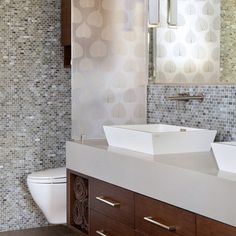 I like the idea of doing a resin panel (ex: 3Form) instead of a wall/half wall for privacy...I like the tile but not crazy about how much there is!