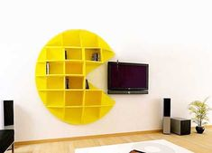 Just about everyone will instantly recognize the simple yellow face of Pac-Man…but for legal purposes, this version is called Puckman. The bright yellow bookcase hangs on the wall, holding anything you need it to and adding a definite sense of nostalgia to anyone who spent hours playing the classic game. The hilarious Puckman bookcase might eat your TV, but he'll keep you safe from the Ghosty Lamps also made by Ginepro Design.