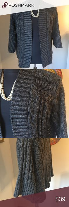 ⭐️CHICO'S LOVELY CARDIGAN 💯AUTHENTIC CHICO' S LOVELY CARDIGAN 100% AUTHENTIC. STUNNING AND STYLISH TOTALLY ON TREND! BEAUTIFUL IN GRAY WITH SILVER THREADING. IT IS A SIZE 3 IN CHICO's WHICH CONVERTS TO A ROOMY LARGE Chico's Sweaters Cardigans