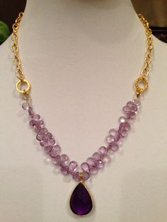 Necklace made with amethyst drops and paired with rich gold