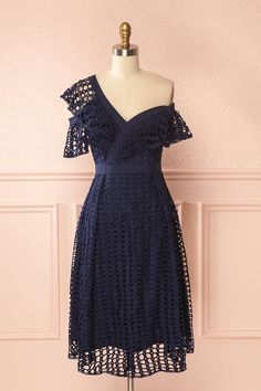 Raita Navy #Boutique1861 / This adorable dress features pastoral charm and retro elegance! The openwork crochet gives texture and originality, draping beautifully over the smooth lining. Fitted through the bodice, it will show off your silhouette. The asymmetrical straps and ruffles are unique, while the zipper in back is a practical addition.