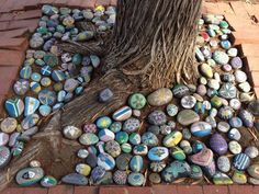 See source page 8 of 8: painted rocks instead of mulch - how fun - Surround your favorite tree with hand-painted stones for a personalized, artsy touch