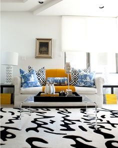 graphic creme and black sofa, mustard and sky blue accent pillow/throw