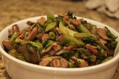 Good Greens~Tip, leave out the bacon and replace with a compliant oil~  1 pound of bacon, diced   1 small red onion, sliced  2 cups sliced mushrooms  1 cup green beans, diced  2 bunches greens of your choice, finely diced (I used a huge bag of braising greens from my CSA which was a combo of kale, collards, and I think some turnip greens)  1 teaspoon rubbed sage  Black pepper to taste