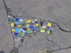 Mosaics in sidewalk cracks! Thanks for this idea!!!!! Something like this with pebbles in the driveway?