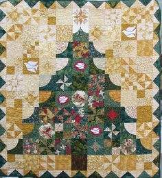 "O Tannenbaum, 60"" x 66"", scrappy pieced tree quilt  pattern with some applique. Featured in ""Christmas at Home, Quilts for Your Holiday Traditions"" as seen at Eudora Quilt shop"