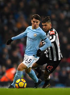 City player Brahim Diaz (l) holds off DeAndre Yedlin of Newcastle during the Premier League match between Manchester City and Newcastle United at Etihad Stadium on January 20, 2018 in Manchester, England. - 123 of 178