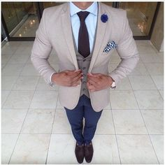 5752570282ef50 Pair a grey waistcoat with navy chinos if you re going for a neat, stylish  look. Why not introduce dark brown leather tassel loafers to the mix for an  added ...