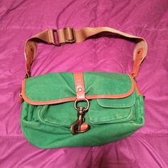 Cute small green purse Cloth purse with metal hook clasp. Pin hole marks on front from buttons/pins previously decorating it. Besides those, still in good condition. American Eagle Outfitters Bags Mini Bags