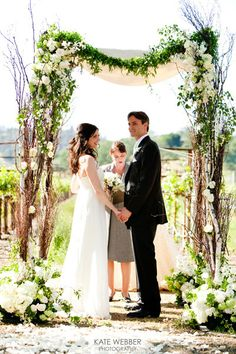Natural birch arch with a draping garland. #wedding #arch #ideas