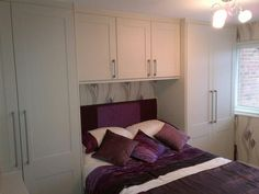 wrapped neatly around the bed, these wardrobes make the absolute most of the space available