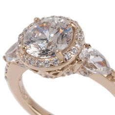 Same ring, but a better view of the beautiful basket and peekaboo diamonds, even under the sidestones!