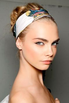 Cara Delevingne. Peachy pink cheek colour and a peach pink lip colour. With again a peach pink toned eyeshadow. The cheek colour has also been used to shade the temple/brow area. This looks particularly pretty when pictures are taken from this angle.