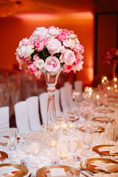 Tall pink floral centerpieces with roses