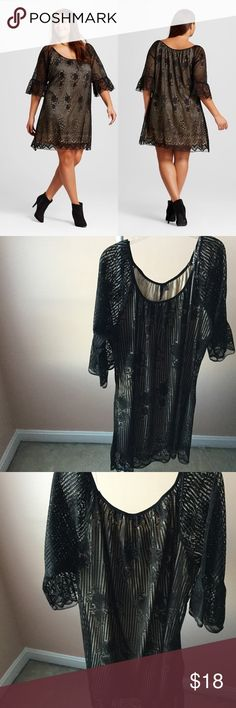 """Black Lace Peasant Dress NWT Size 2X Draped in luxe lace with ruffle sleeves adding a boho touch. Above-the-knee length is youthful and flirty. 3/4 length sleeve, pullover with no zipper.  This is a perfect statement dress for any occasion: wedding guest dress, formal, bachelorette party, girls night out, or date night  Materials: 100% Polyester  Measurements: Suggested size 20W or 22W 46.5"""" - 48.5"""" bust 43"""" - 45"""" waist 51"""" - 53"""" hip  🚫Trades 3Hearts Dresses Mini"""