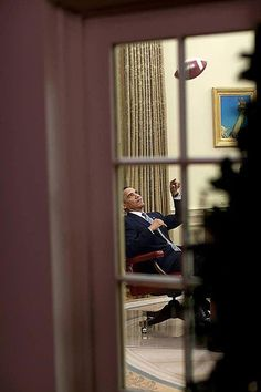 Photos of Obama Being Awesome: Tossing A Football in the Oval Office