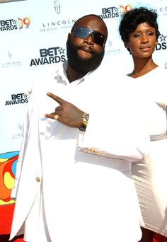 Rick Ross....and who is the chic in the background....highly upset!