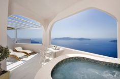 Andromeda Gold Suites Hotel in Santorini. A complex in Greece, sanctuary of romanticism for couples, perched atop the highest point of Imerovigli near Fira.