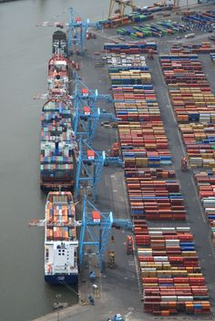 Aerial shot of Port of Liverpool, 4 huge ships and a lot of shipping cans.