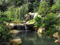 handmade ponds with waterfalls for homes | This pond with waterfalls is one of my favorites. We built it using ...