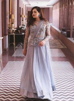 A peplum gown is what we say a perfect outfit for your roka ceremony! Indian Wedding Gowns, Indian Gowns Dresses, Indian Fashion Dresses, Dress Indian Style, Indian Designer Outfits, Indian Weddings, Indian Bridal, Indian Outfits, Choli Designs