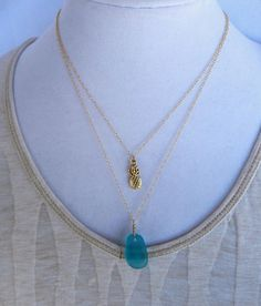 Bright Caribbean blue sea glass pendant on 14k gold necklace