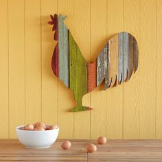 """RUSTIC HOMESTEAD ROOSTER -- Our bright bird has something to crow about, handcrafted as he is from reclaimed wood beadboard, vintage moldings and antique ceiling tin, still colored with original paints. Colors and textures will vary. USA. Catalog exclusive. 29""""W x 3""""D x 31""""H. Additional shipping, $15."""