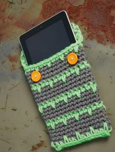 Crocheted Tablet Cover - Cool design meets creative craft. If you're looking for a gift for someone special, you can't go wrong with this tablet cover.