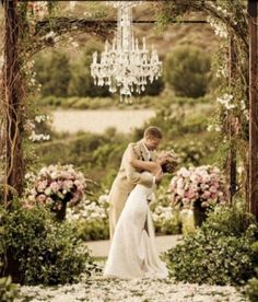 Vintage outdoor wedding arch with crystal chandelier