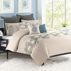 Bring a light and airy feel to your bed with this nature-inspired duvet cover. Embroidered leaves in shades of green, blue and ivory on a taupe background and pintuck details give it effortless...