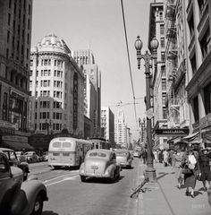 "April 1942. ""South Hill Street, Los Angeles."" Now playing at the Warner: The Male Animal. Photo by Russell Lee for the Office of War Information."
