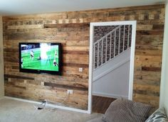 Pallets can enhance the look of any boring or shabby wall of the house. Wood paneling with pallets is the best and easiest way to utilize pallets and up cycle them in creative and innovative way. You can beautify the wall of your living room by this pallet wood wall paneling.