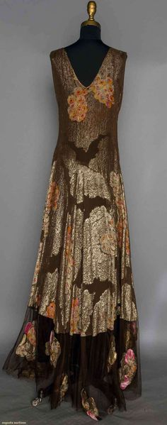 1930 Chocolate brown silk brocaded in gold lame cartouches w/ printed orange & pink blossoms, net hem edge w/ printed lame appliques. Back
