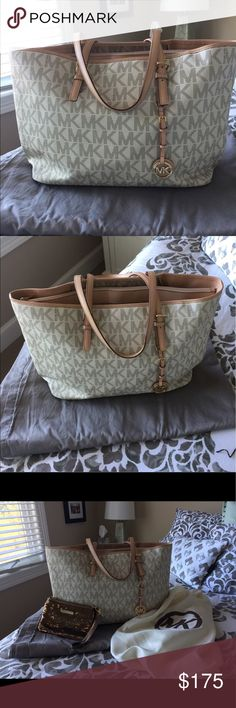 Michael Kors large jet set bag In great condition! Michael Kors large jet set bag. Middle compartment perfect for laptop, with zip closure. Bronze sequin Wristlet included. Michael Kors Bags Totes