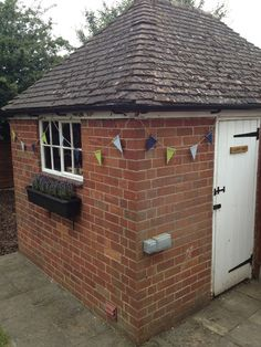 garden shed with bunting - how to make wooden bunting for your garden #craft #diy #bunting #homemade