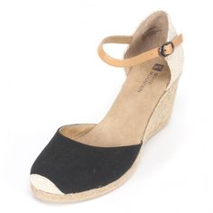 White Mountain Shoes Mamba Black Wedge Woven rope wedge with rope sole. Stripy canvas fabric with solid heel fabric. Ankle strap with buckle. Online Exclusive! Back by Poplar Demand and in a dazzling array of colors! Take your summer look to new heights in these vacation ready wedges.