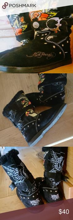 | Ed Hardy | 'Boot Straps' in Black, Size 7 Every wardrobe needs Ed Hardy!  - Size US 7 (Women)  - Stud detailing, boot straps and tattoo print, lined with warm fur.  - Superb Quality! I have owned and cherished these boots for over 10 years and the fact that they are still sturdy, with designs and studs all in tact - truly shows the workmanship and care that go into each Ed Hardy product.  - Pre-loved, some slight wear but nothing noticeable unless you are really looking for it…