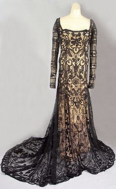 Hand-embroidered tulle gown, c.1910, with hand-appliquéd lace inserts and back train. From the Vintage Textile archives.