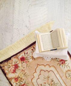 Open Mushaf on Prayer Mat