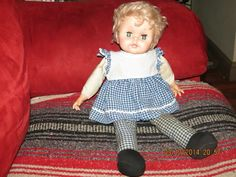 I had this doll. She had a pull string on her back and talked.