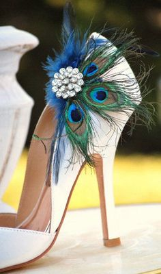 if you want to go with peacock feather thing, easy way to jazz up a plain colored shoes would be a shoes clip, something kinda like this.