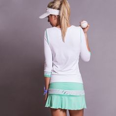 Soft microfiber-mesh 3/4 sleeve TENNIS top with green piping detail at sleeve. Proudly made in the USA! Buy Activewear http://www.denisecronwall.com/#!product/prd13/2521067301/calypso-3-4-sleeve-top