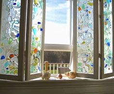 glue sea glass to window - THIS BLOG HAS A LOT OF DIFFERENT PROJECTS THAT CAN BE MADE WITH SEA GLASS.