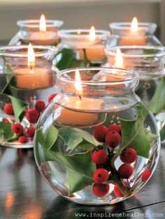 Holly leaf with berries in water topped with white floating candle. Or float a tealight in a tumbler of water or float several in large colored glass bowl.  Could try centerpiece of candles in middle & circle of colored glass ie blue glass wine bottles filled with seasonal flowers or glittery white birch twigs.