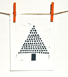 use rubber on end of pencil to print, mostly green with a few dots of other colours for baubles - christmas idea for kids