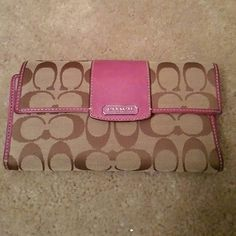 """Authentic Coach Wallet 100% Authentic check book wallet. Light tan fabric with Brown signature """"C"""" pattern with pink/purple leather details and inside. Coach Bags Wallets"""